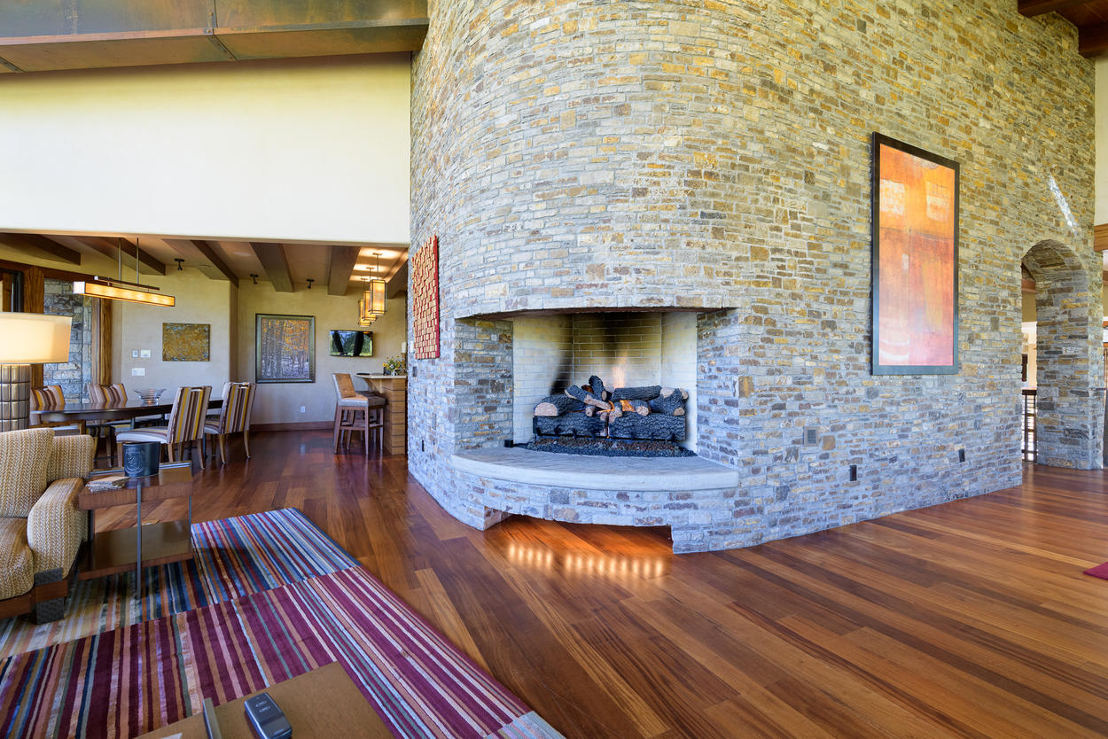 The fireplace is a sturdy centerpiece in the Great Room.