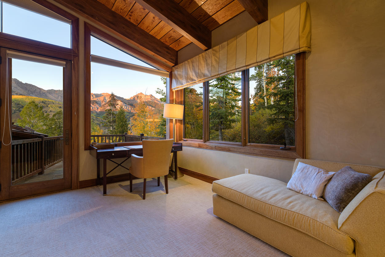The Master Bedroom also has a desk and chaise lounge that faces the mountain, and access to a private deck.