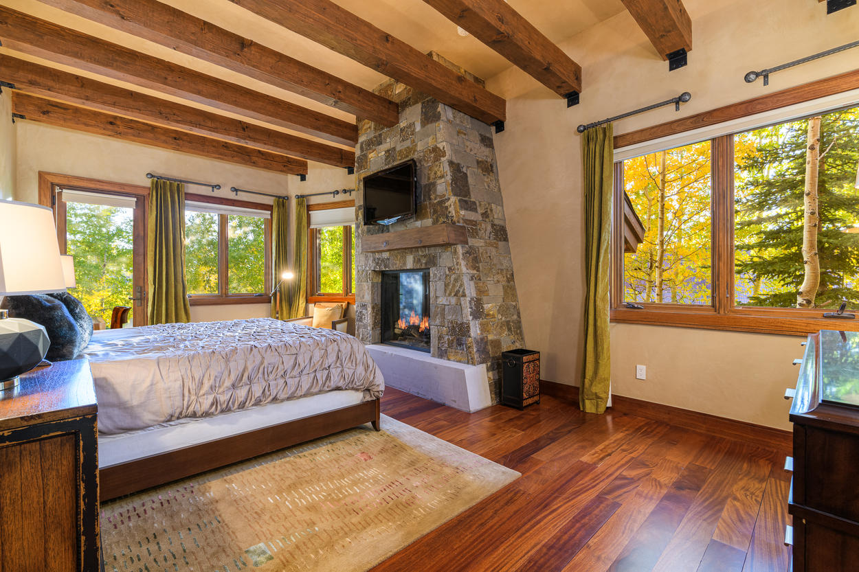 The King Guest Bedroom is on the first floor and features a large stone gas fireplace.
