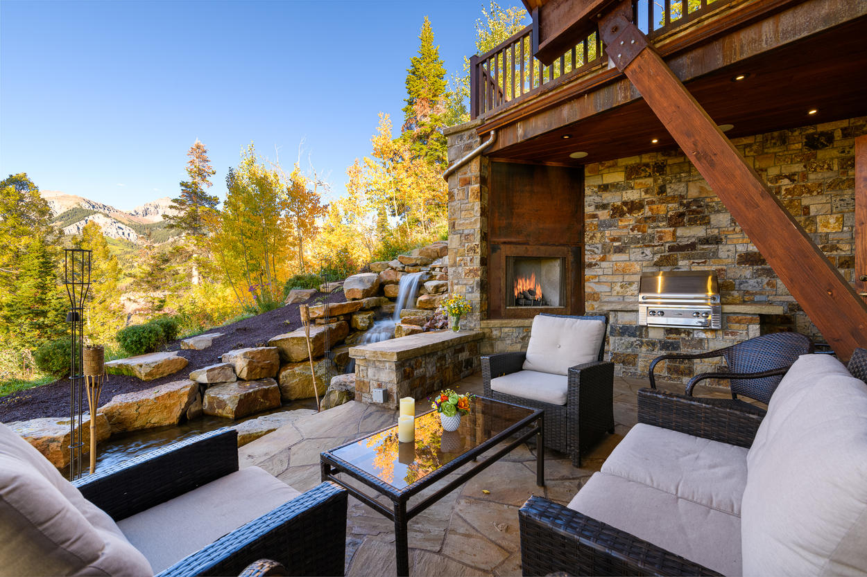The main patio outside the Great Room has a waterfall feature, outdoor fireplace, and plenty of seating.