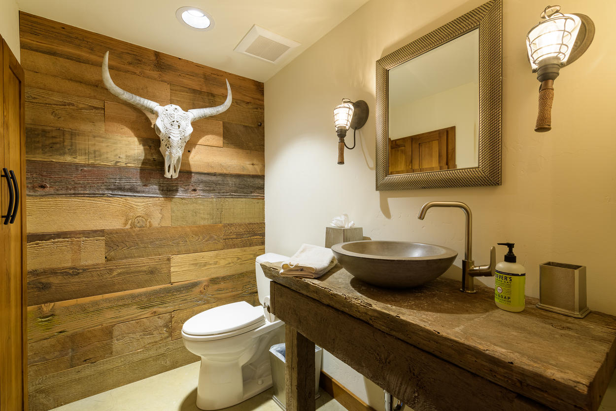 The powder room on the lower level is in keeping with the home's Mountain Modern aesthetic.
