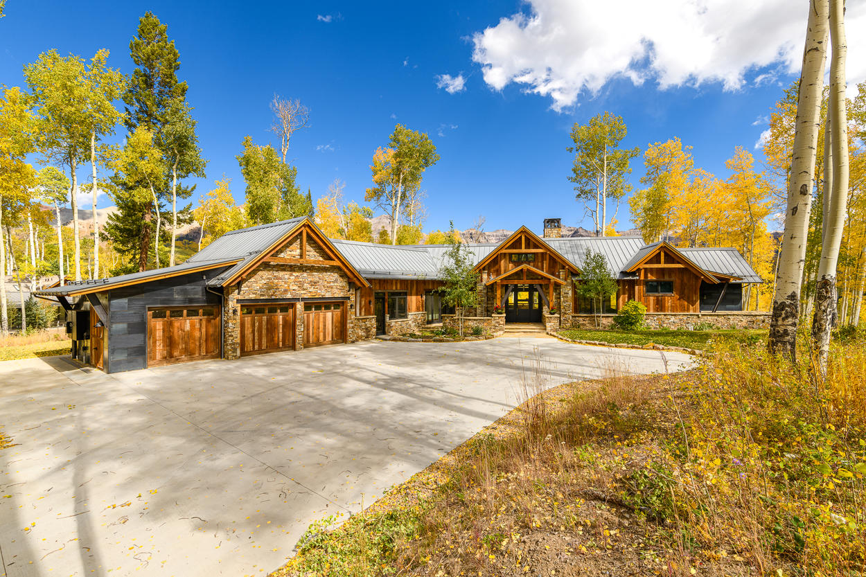 With wood beams, stone columns, and gables, this home has exceptional mountain beauty.
