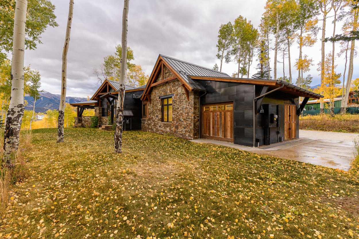 The Highlander is built into the hillside on two levels, with a driveway on the main upper level.