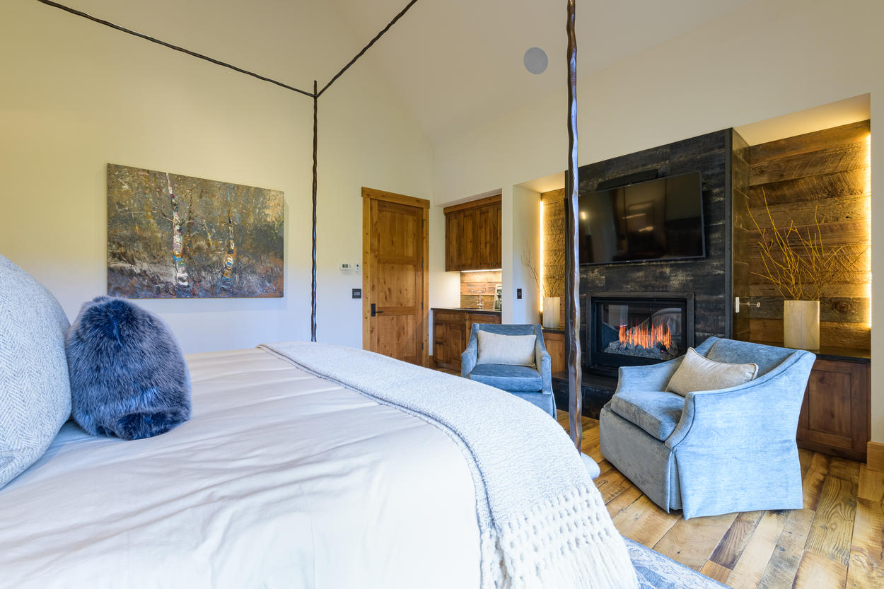The Master Bedroom also has its own mounted TV and a gas fireplace.