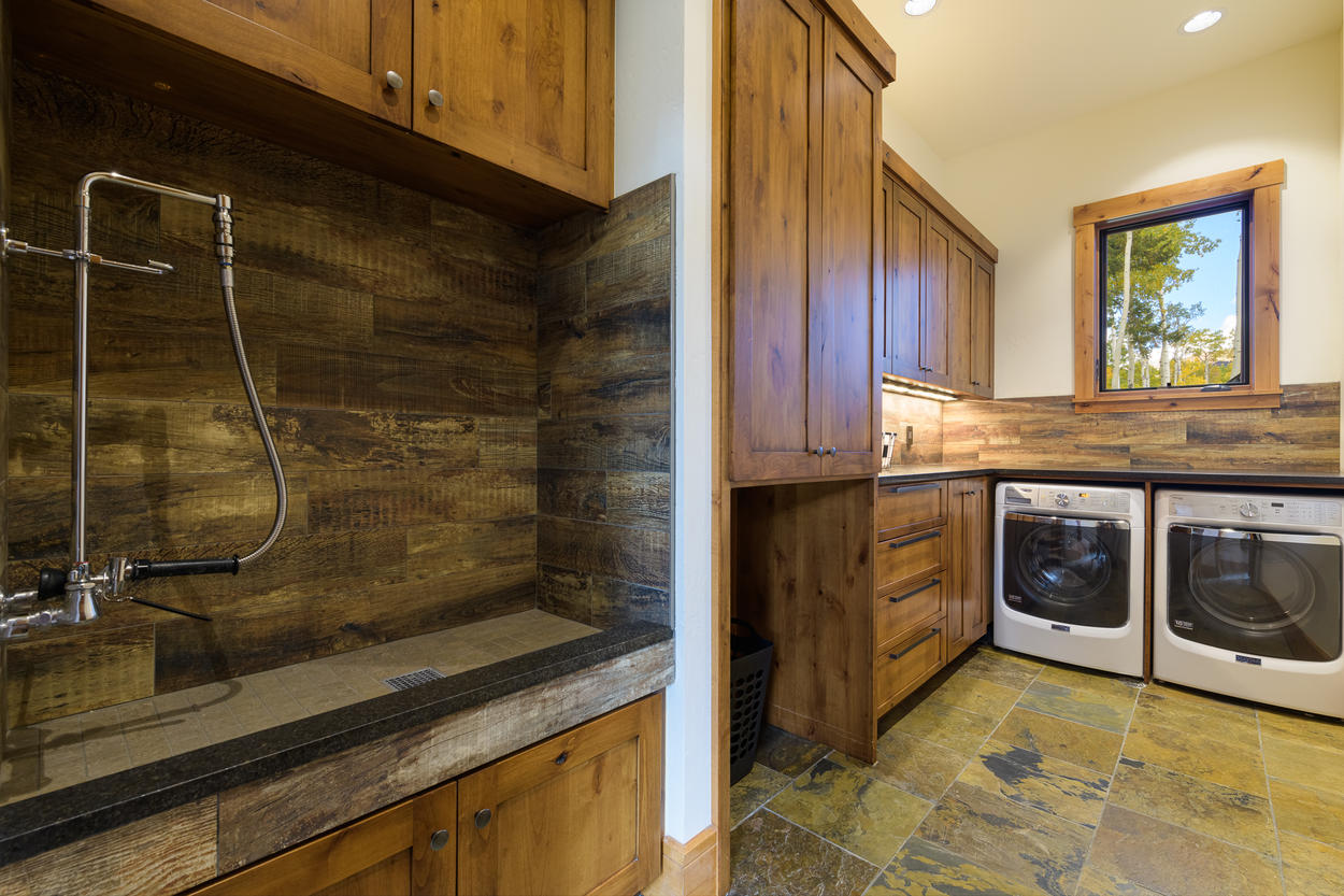 There's a laundry room on the main level with a wash sink, washer, dryer, and storage.