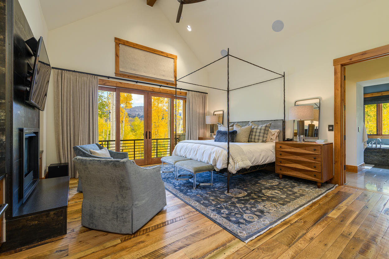 The Master Bedroom is located on the main level and has a king-size bed.
