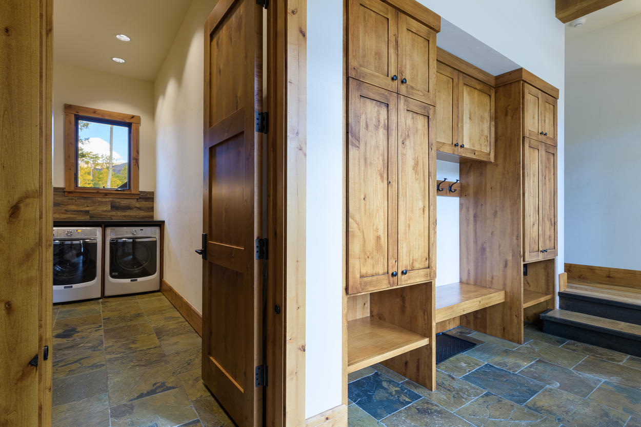 The laundry room is just off from the mud room and gear storage space.