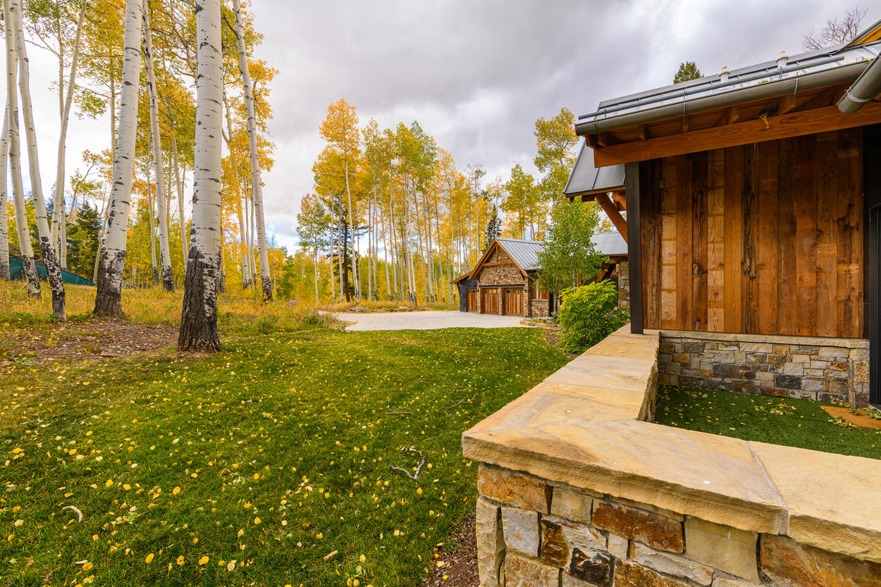 In addition to the walled-in patio, there's a large front yard among the neighboring aspen trees.