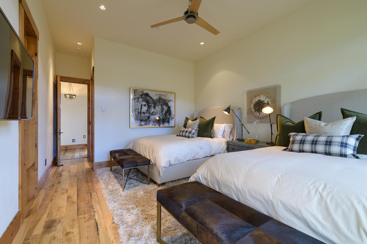 The Queen Guest Bedroom has two queen-size beds and an attached ensuite bathroom.