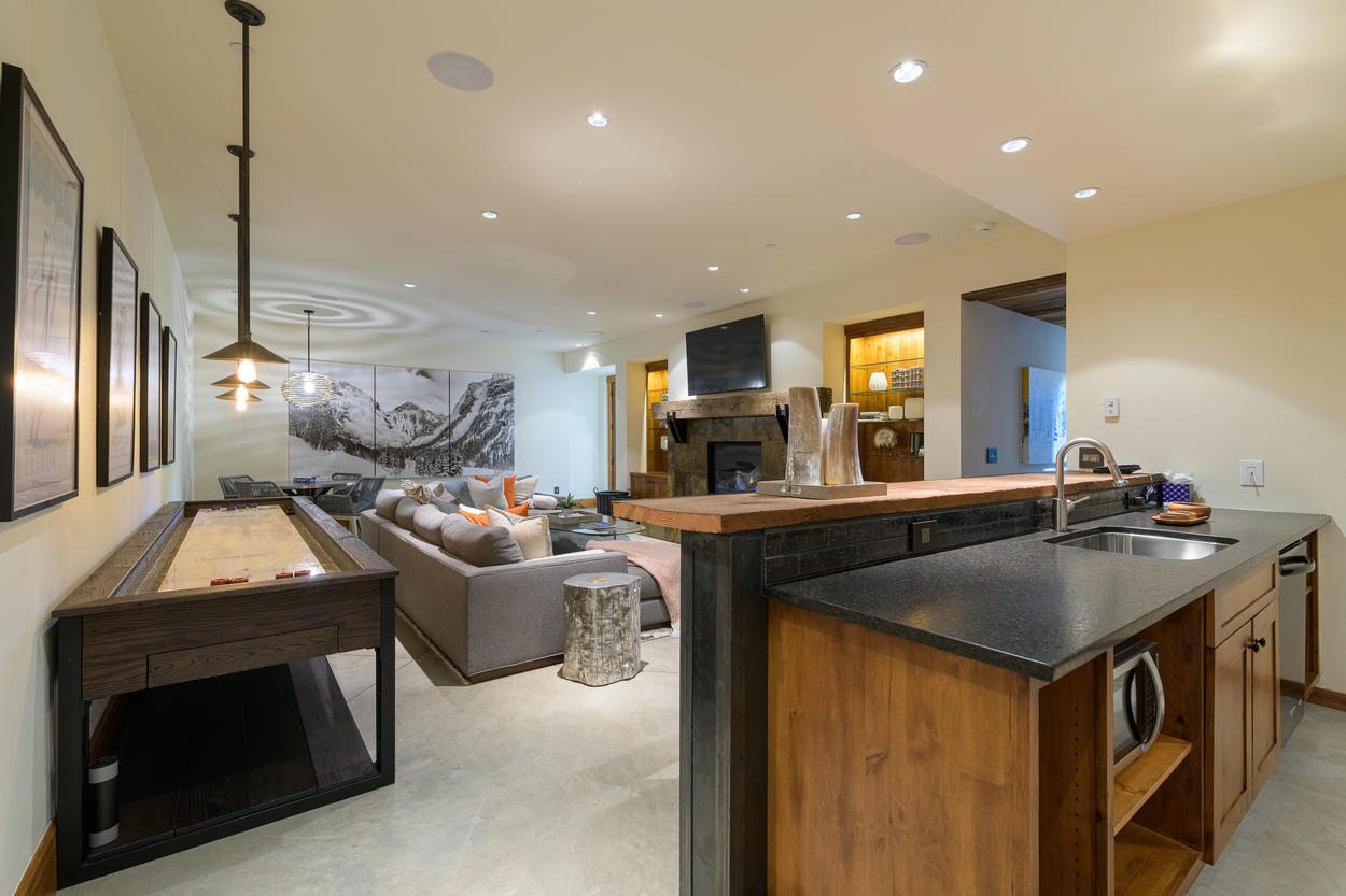 The bar features a kitchenette for easy entertaining.