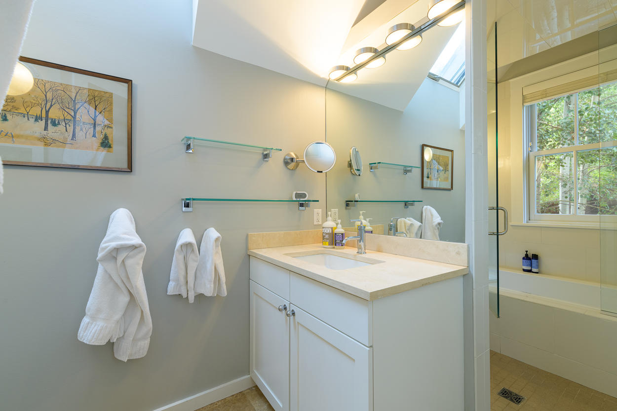 The Master Ensuite has a single vanity and a shower/tub combination.