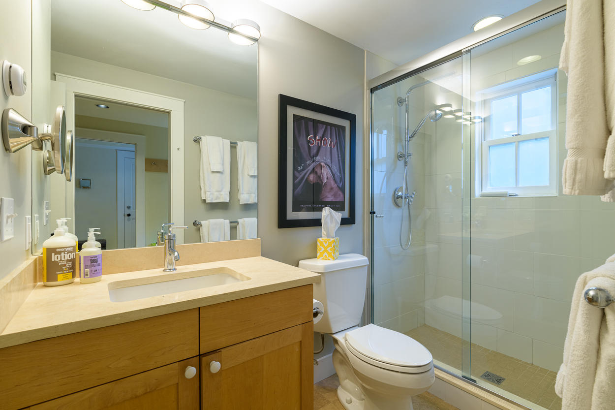 The 2 guest bedrooms on the 1st floor share a full bathroom with a walk-in shower.