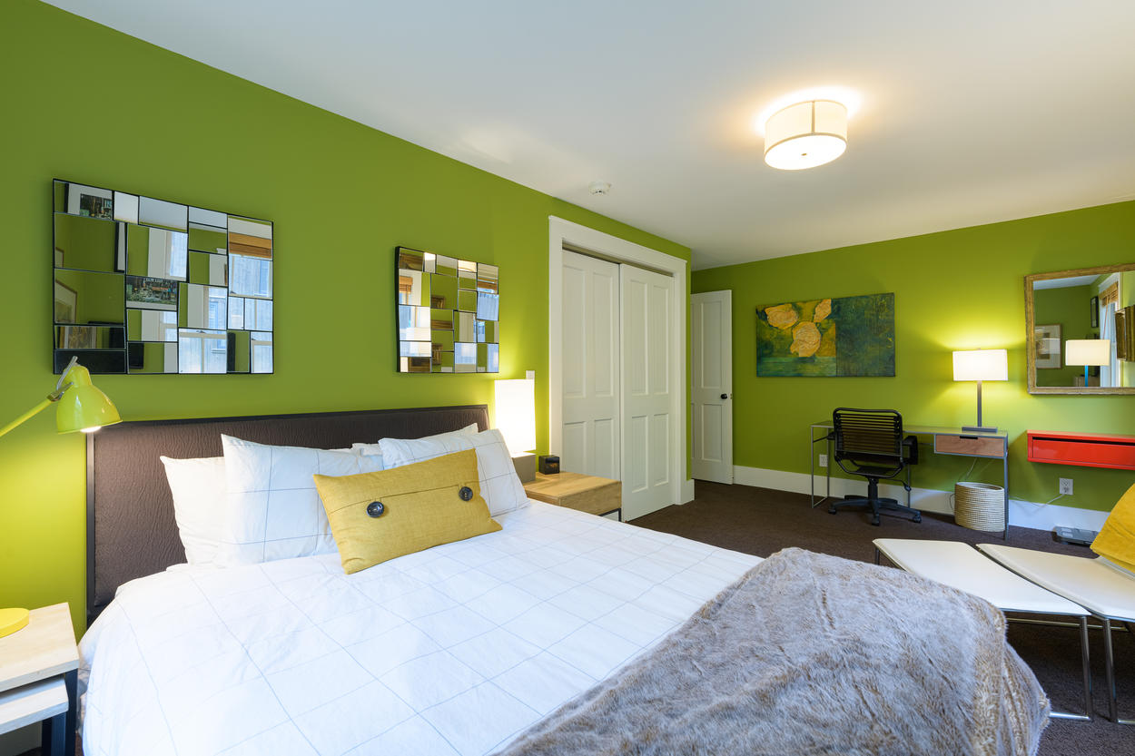 The 1st guest bedroom is located on the 1st floor and has a queen-size bed.