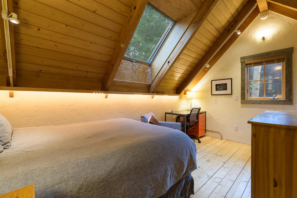 The gabled wood roof slatted ceiling make for an extremely cozy sleep.
