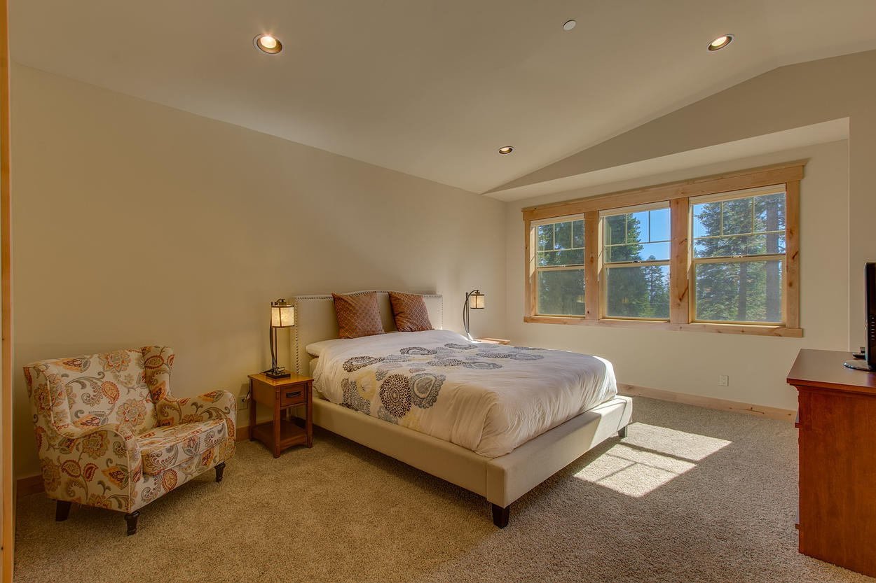 Sink into the second floor master bedroom's california king bed and cozy up with a good book and a calming vista.