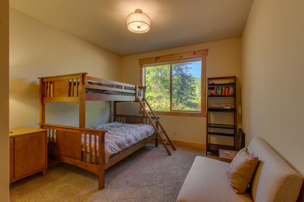 Perfect for kids, the bunk room has a full bed on the bottom and a twin bed on top.