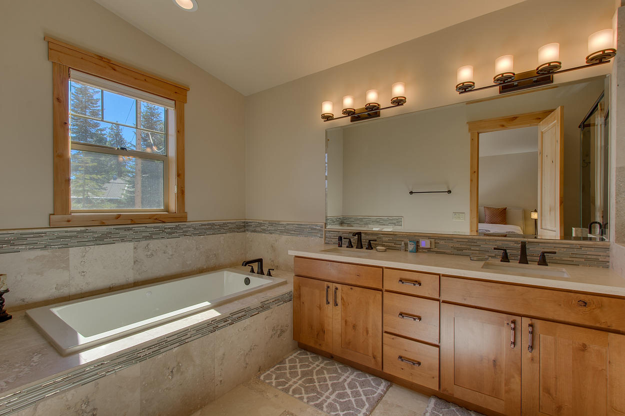 Relax into the master bath's soaking tub after a full day of exploring Lake Tahoe.