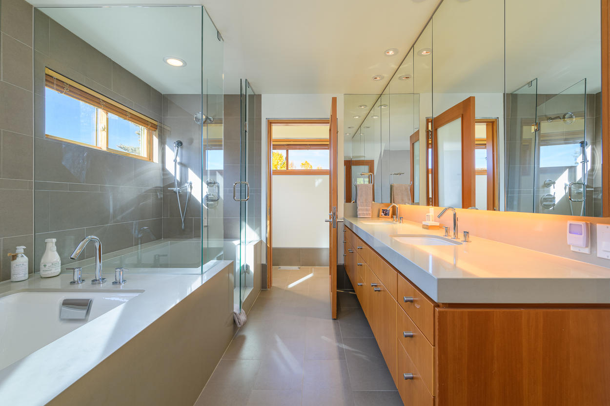 The Master Bathroom also has a large double vanity, walk-in shower, and separate soaking tub.