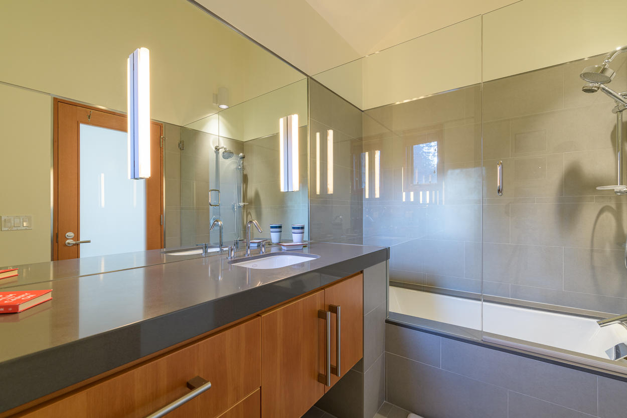 The King Guest Bedroom has its own ensuite bathroom with a shower/tub combination.