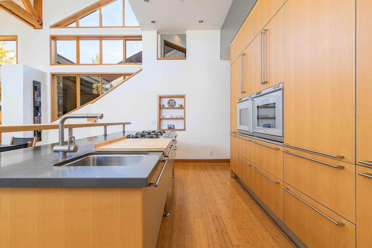 The kitchen borrows elements from modern and galley layouts, and features a stainless steel double oven.