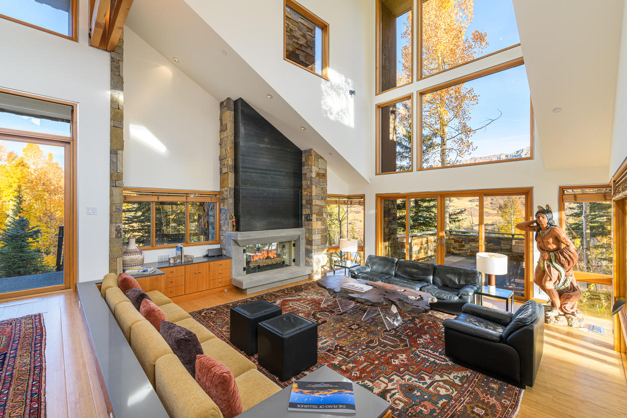 The living room affords guests excellent views out the multi-story wall of windows.