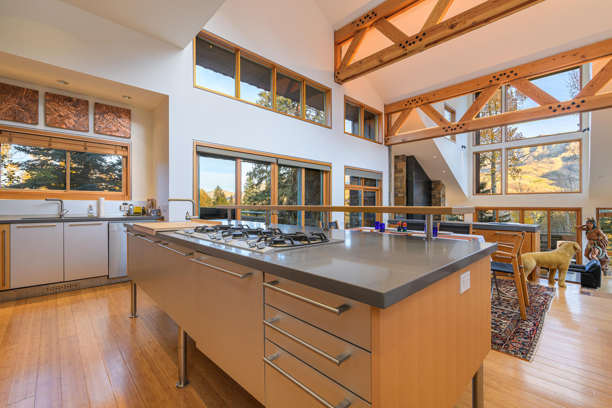 The kitchen features a 6-burner gas stove.