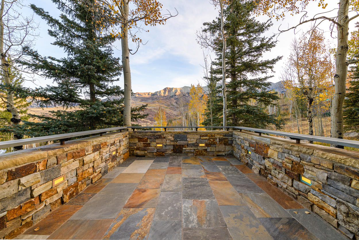 The large back patio has unobstructed views of the famous ridgeline.