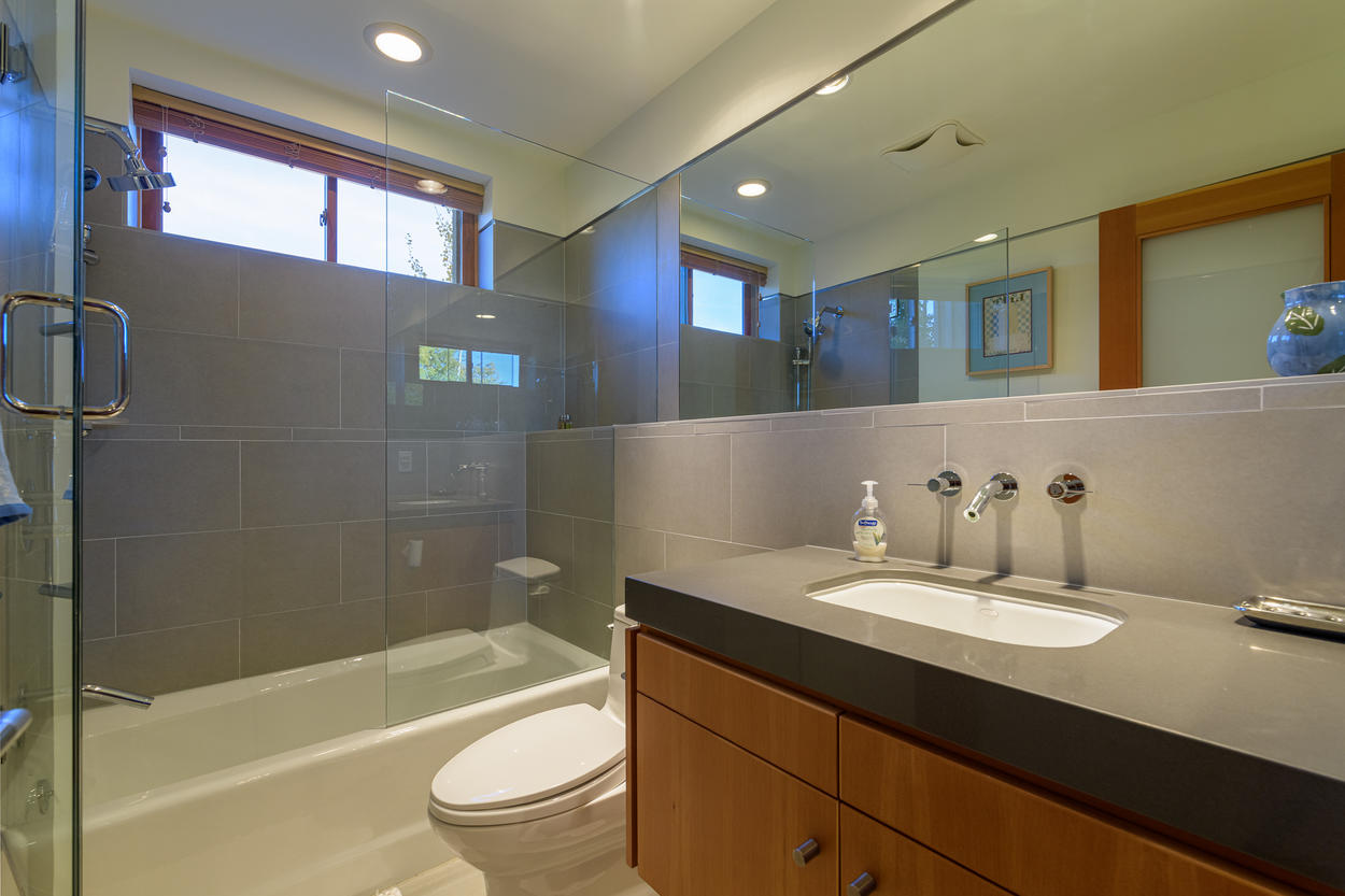 The Twin Room also has its own ensuite bathroom with a shower/tub combination and single sink.