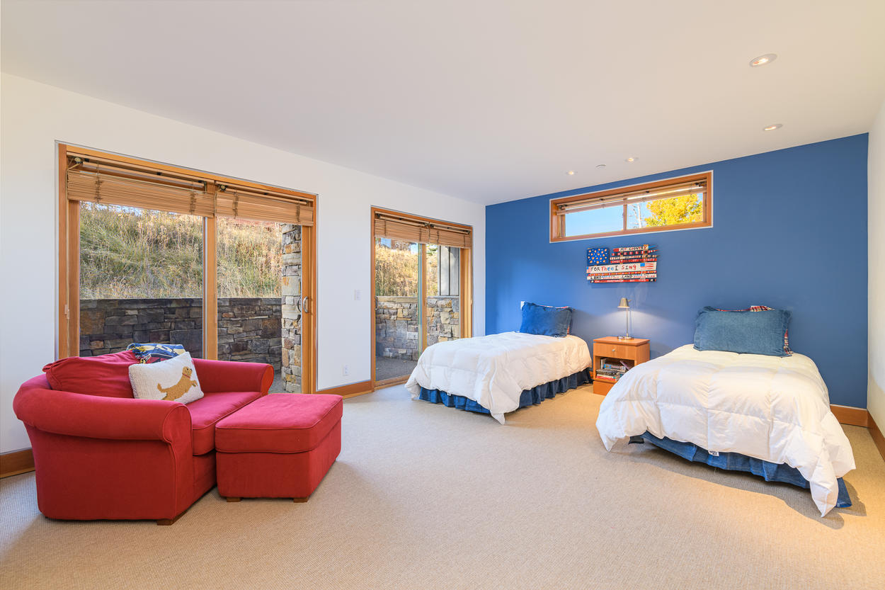 The Twin Bedroom is located on the first floor and has private patio access.