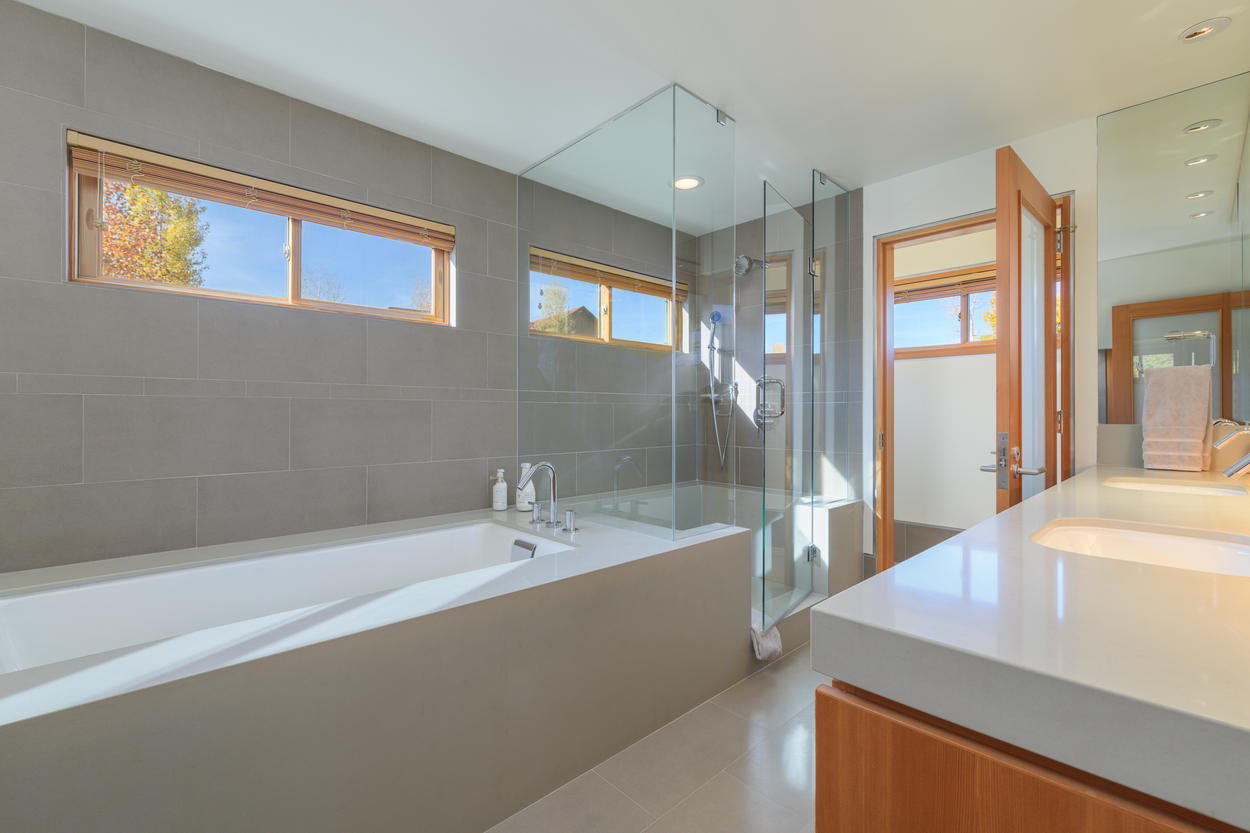 Enjoy a jetted tub and frameless glass shower in the Master Bathroom.
