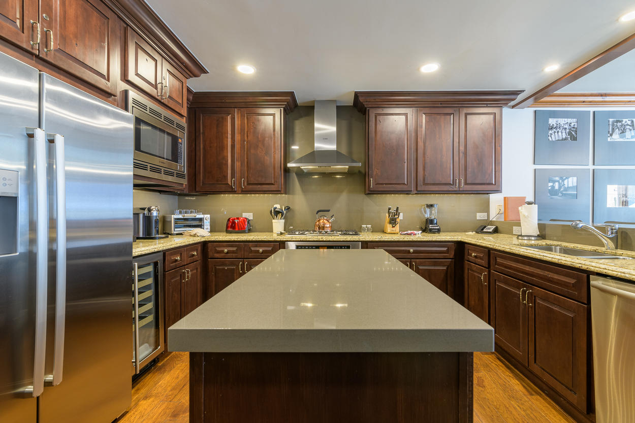 The kitchen island provides additional space for cooking and prepping.
