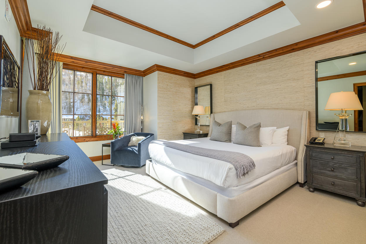 The Master Bedroom has a king-size bed and mountain views.