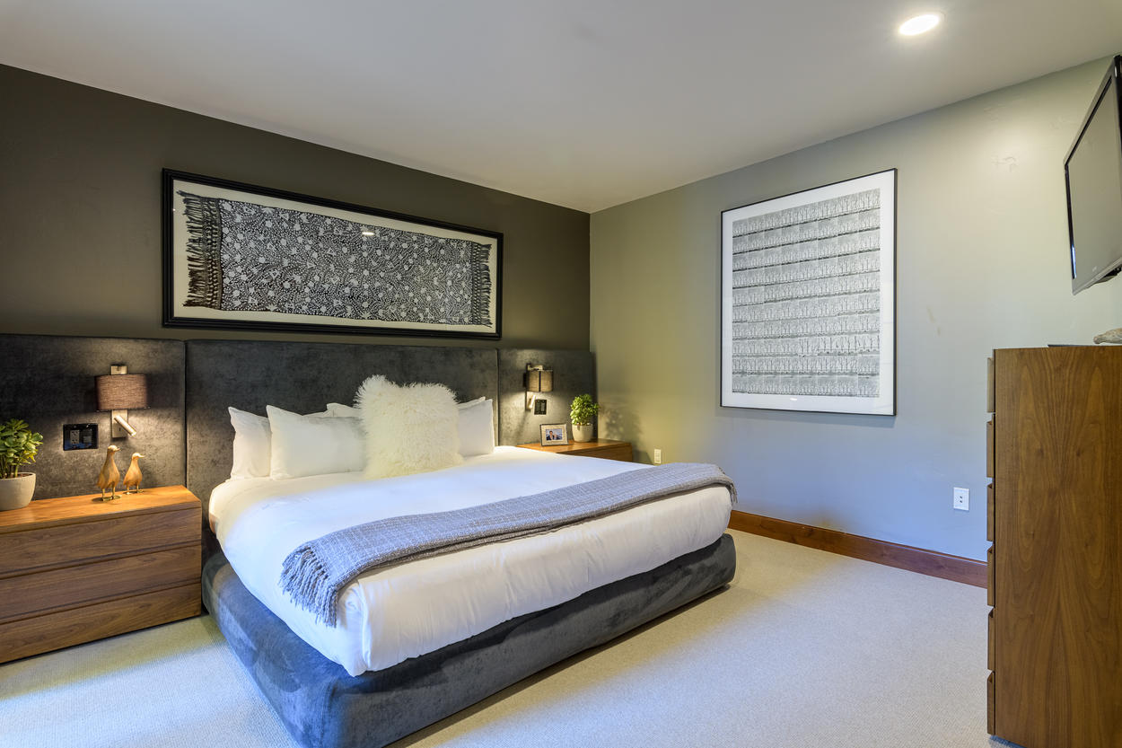 The first guest bedroom has a king-size bed.