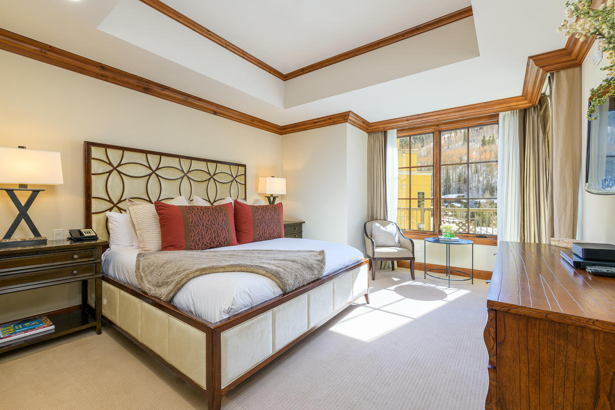 The Master Bedroom has a king-size bed and loads of natural sunlight.