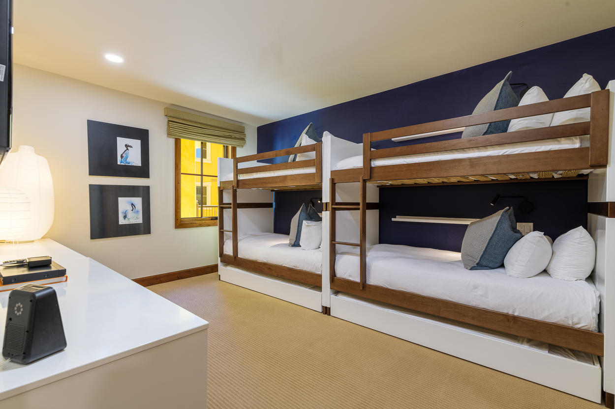The bunk room has two sets of twin bunks and two more trundle beds, for a total of six twins.