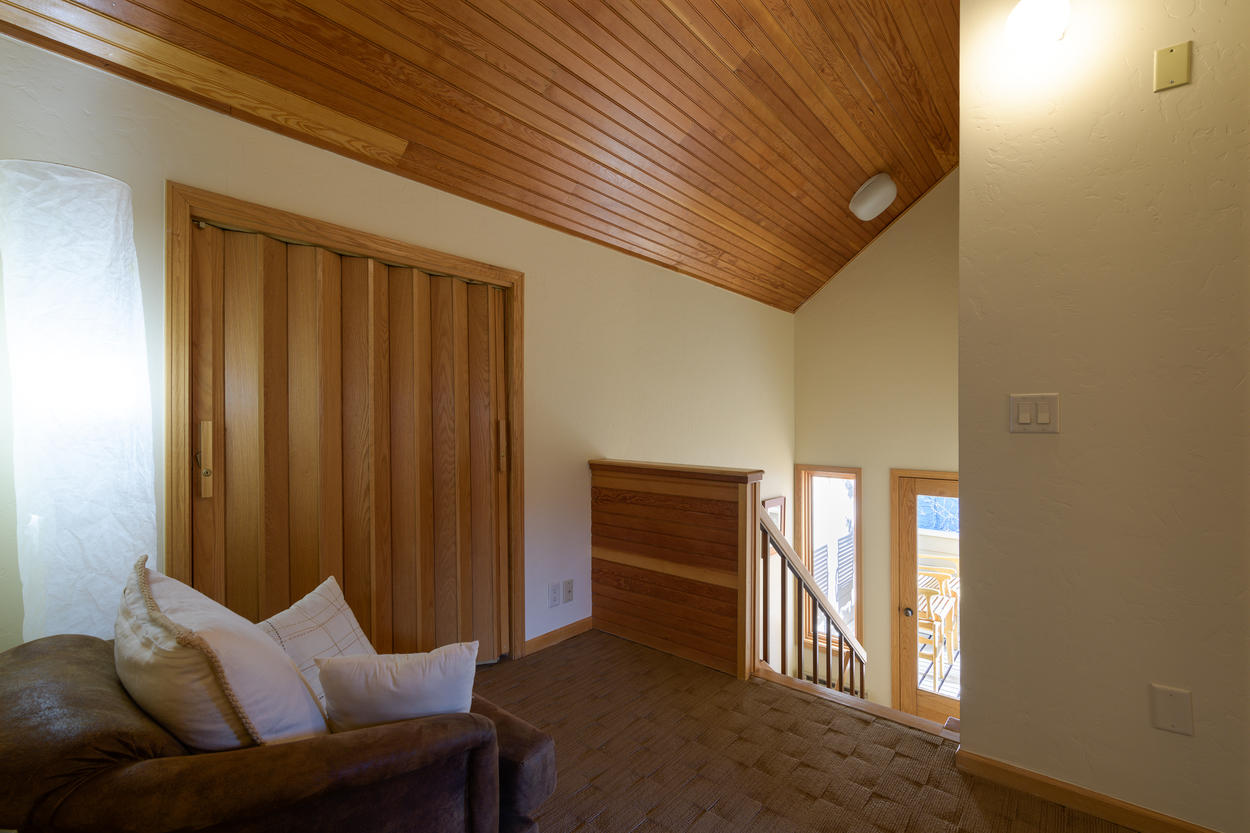 A small landing sits between the 4th floor guest rooms, and leads down to the 4th floor covered deck.