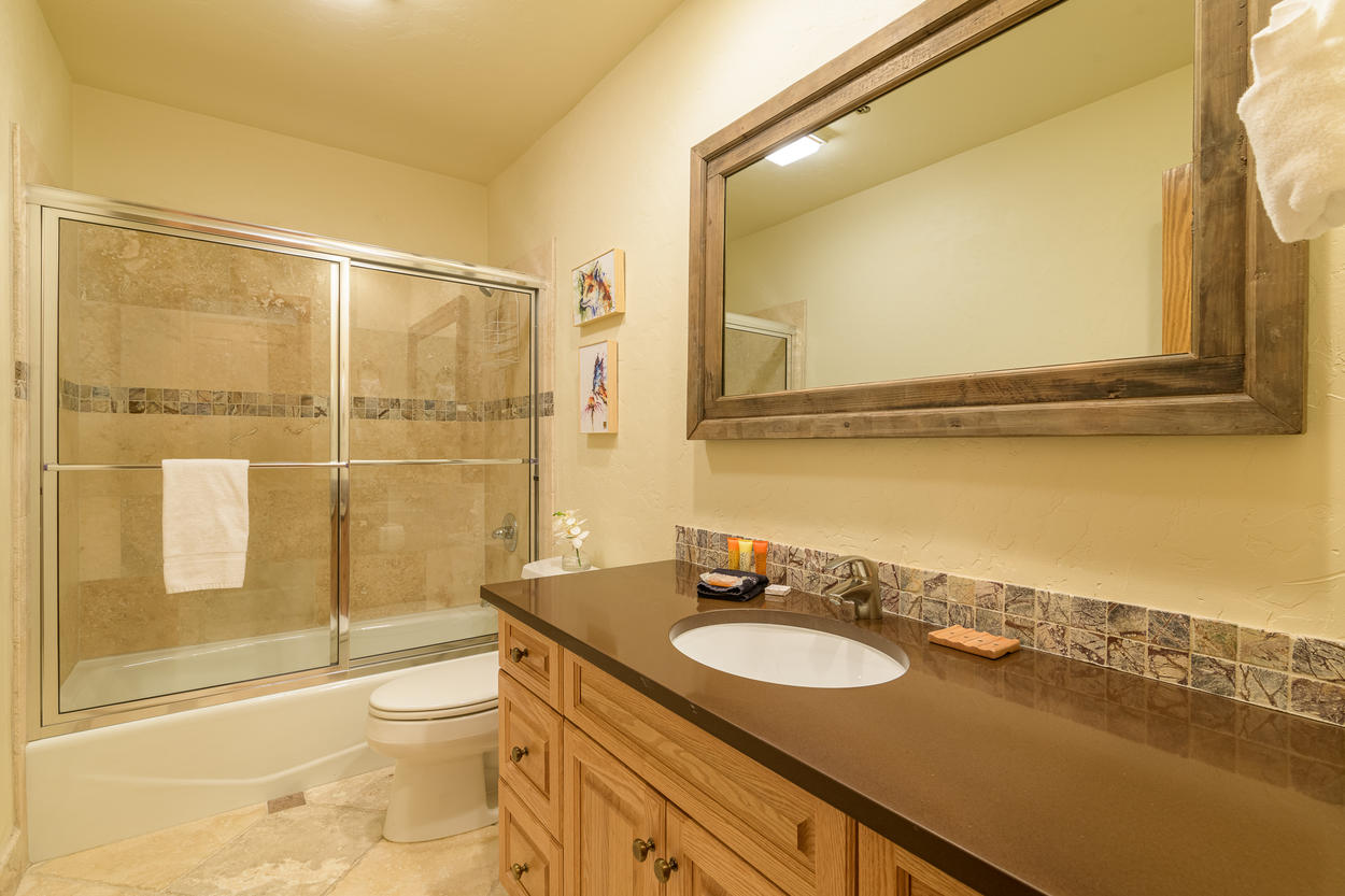 The third floor Queen Ensuite has a single sink and a shower/tub combination.