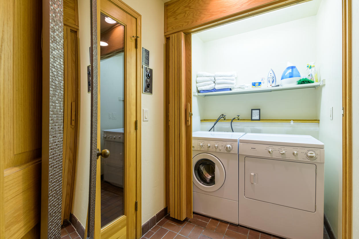 Access the laundry room through the third floor Queen Guest Bedroom.