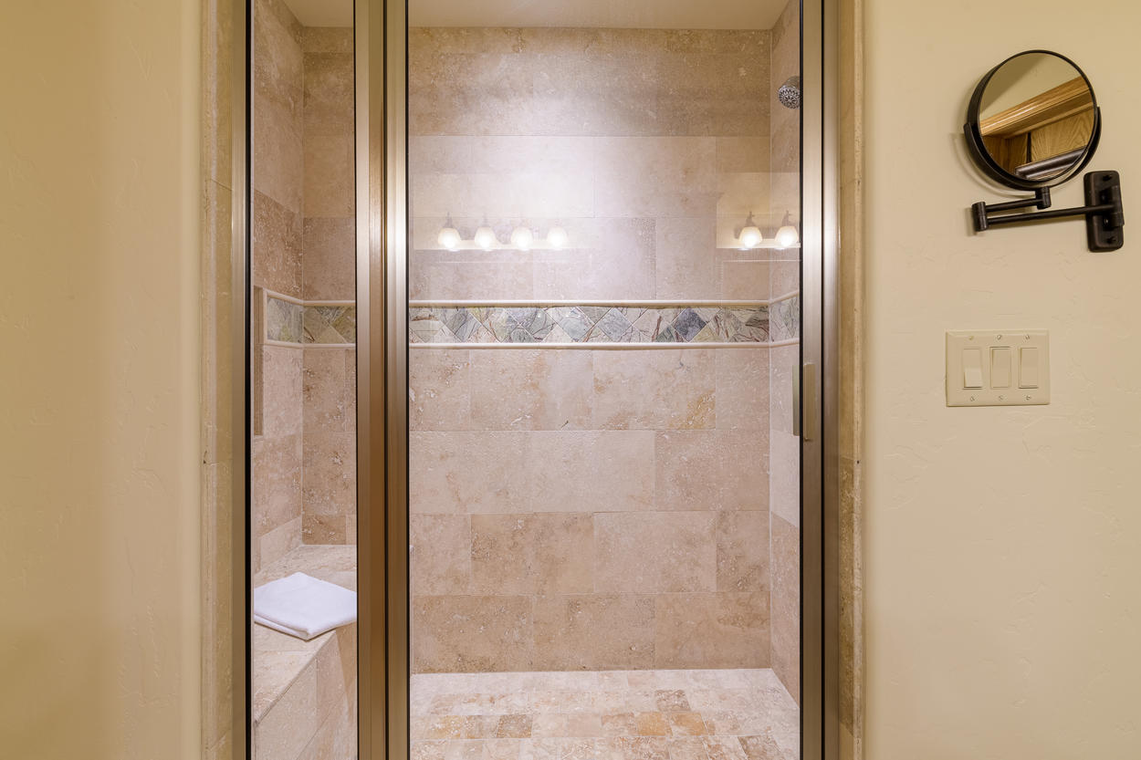 The walk-in shower in the Master Ensuite is spacious and relaxing.