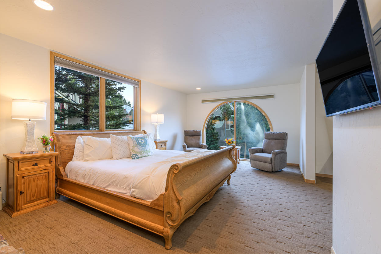 The Master Bedroom is on the 3rd floor, and features a king-size bed and mounted TV.