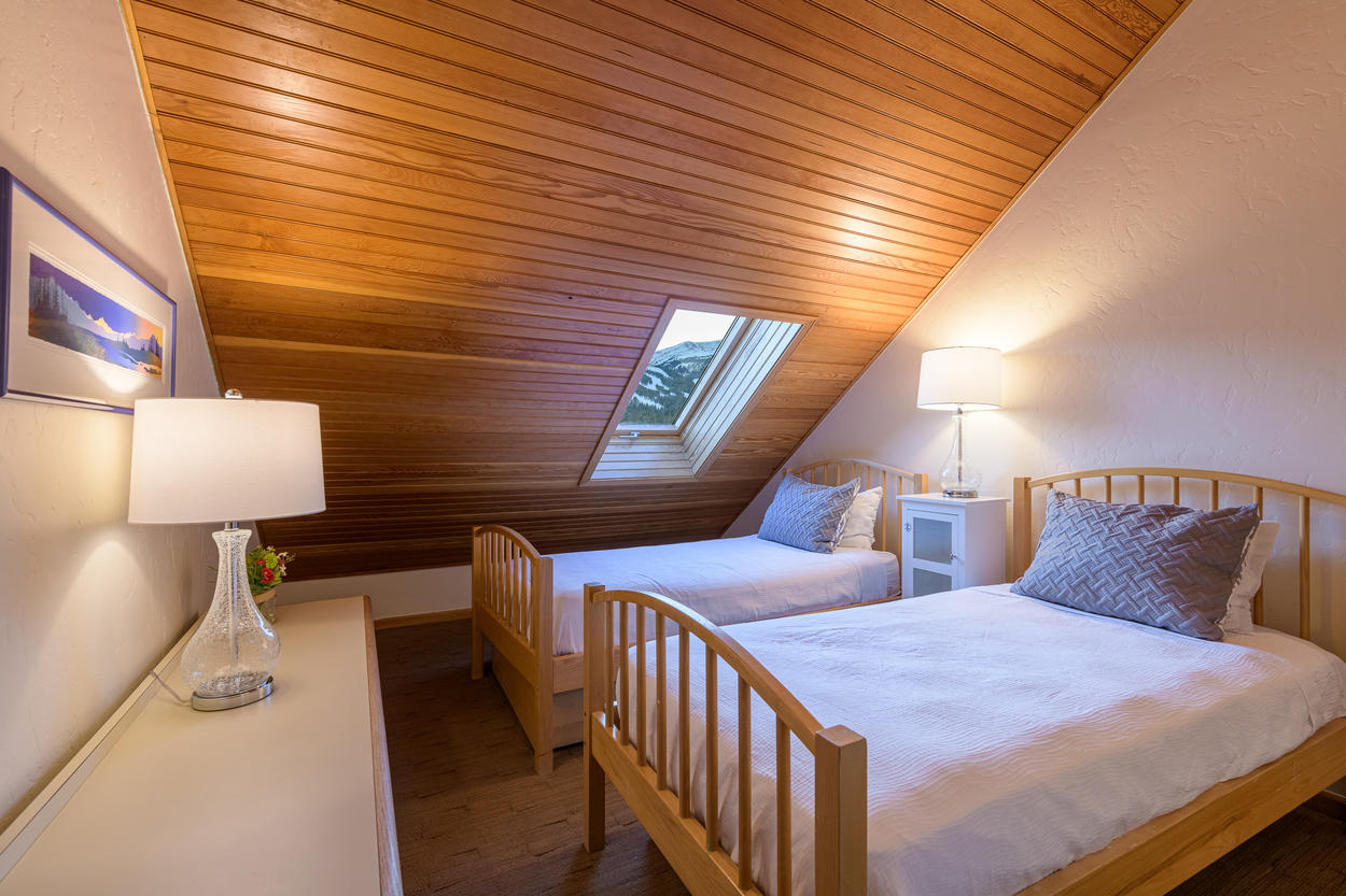 The skylight in the Twin Guest Bedroom has excellent views of the slopes.