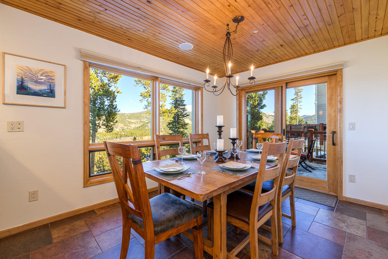 From the dining area, step onto the back deck for unobstructed mountain views.