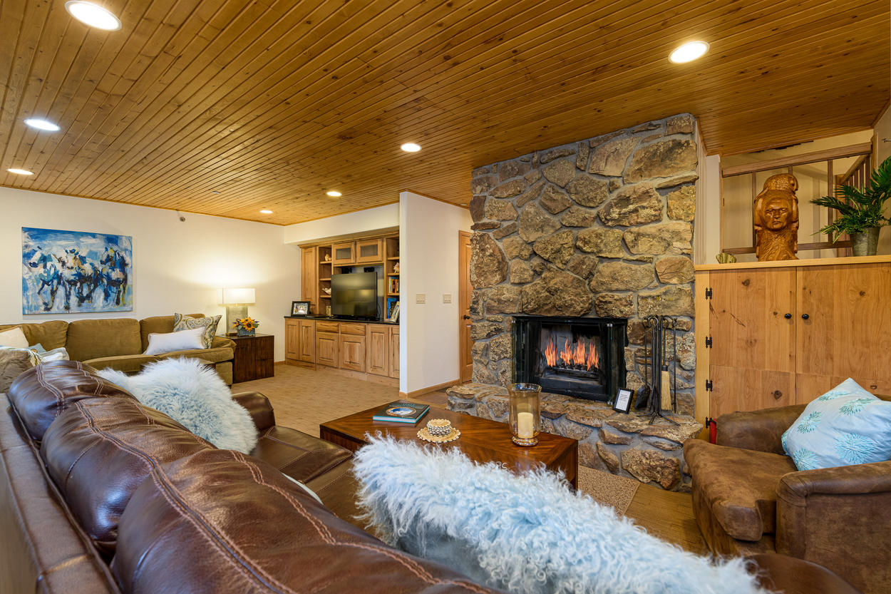 The living room is located on the 2nd level and has a wood-burning fireplace, with firewood provided.