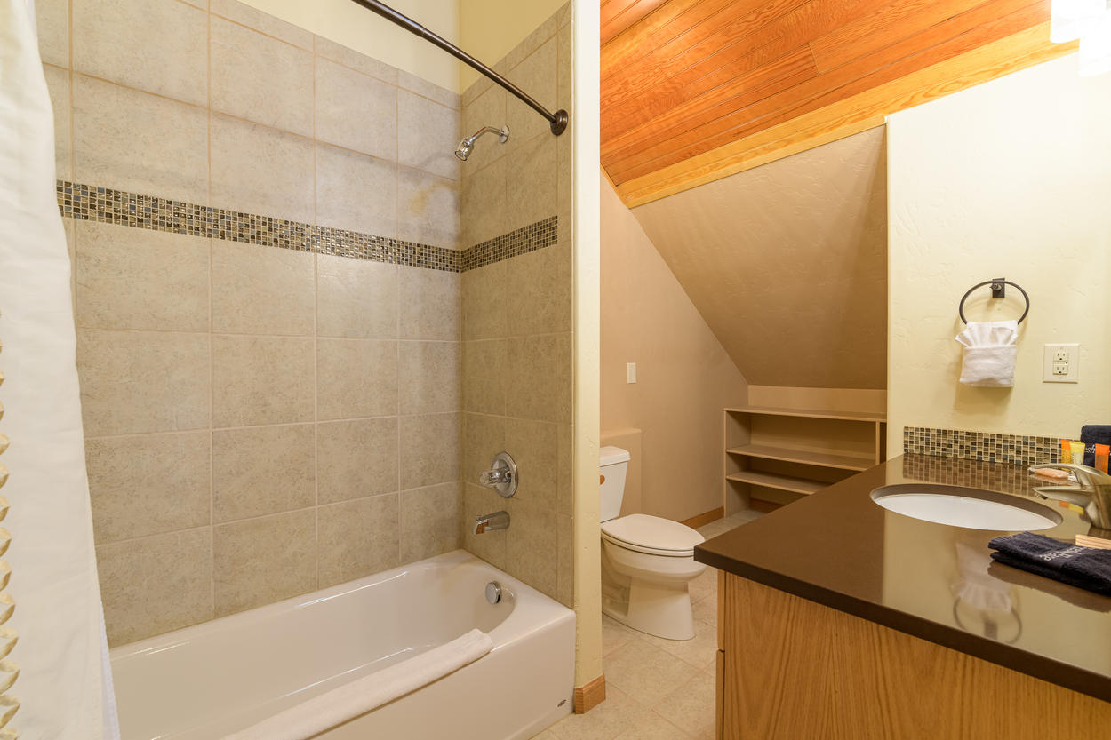 The 4th floor has a shared bathroom with a single sink and a shower/tub combination.