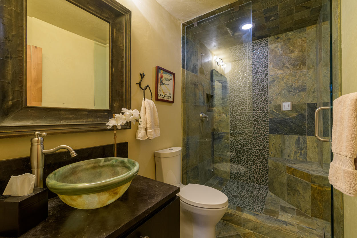 There's another full shared bathroom on the second floor that also features a walk-in steam shower.