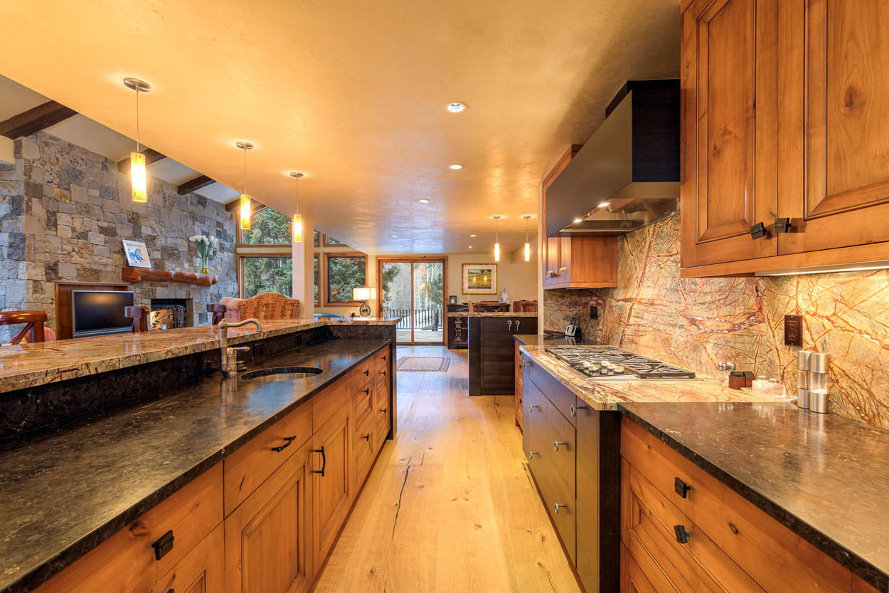 The galley-style kitchen is perfect for both gathering and prepping.