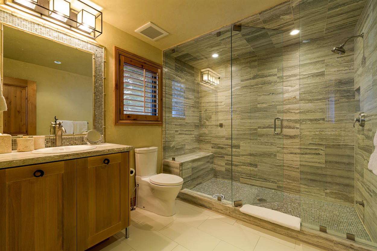 The King Guest Bedroom's ensuite has a large walk-in steam shower and single vanity,