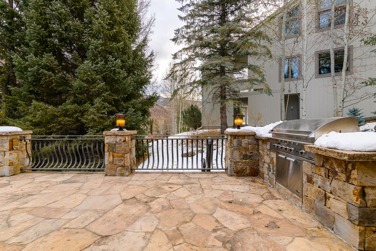 The second-floor patio has a gas grill, and in the summer, is complete with outdoor furniture.