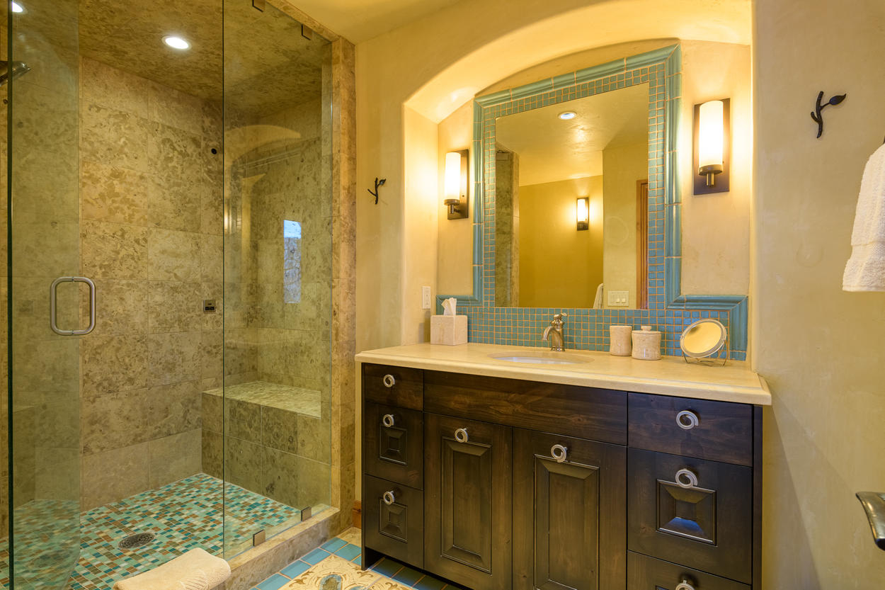 The Second King Guest Bedroom's ensuite has a walk-in steam shower and single vanity.