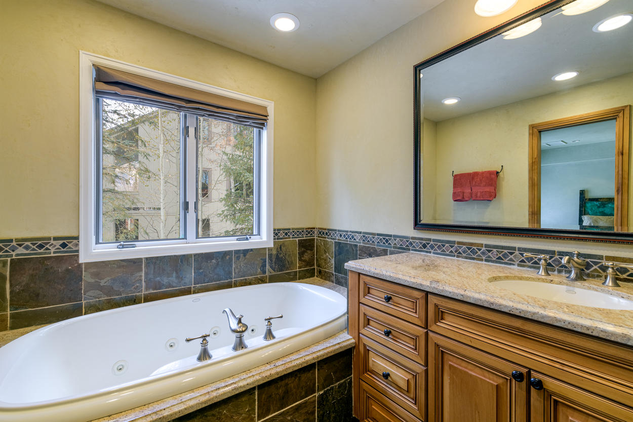 The third floor queen ensuite also features a jetted tub in addition to the steam shower.